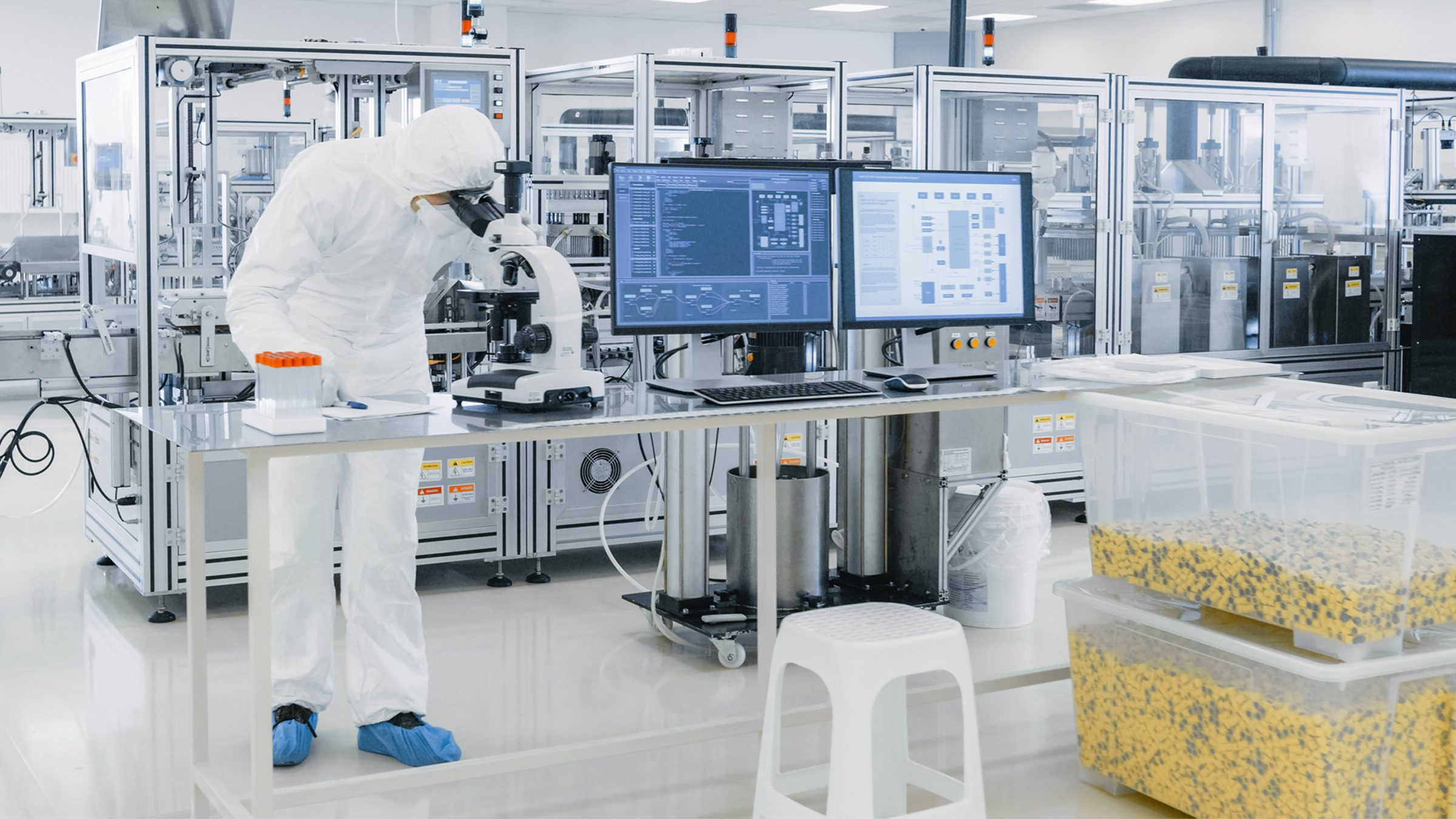 Man working in cleanroom production area 2400x1350px